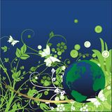 Live planet. Planet the Earth in an environment of a vegetative ornament on a blue background Royalty Free Stock Photography