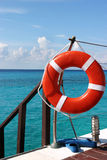 Live Preserver. Life preserver stands at the ready. a pair of flippers were left behind by a person snorkeling Royalty Free Stock Photo