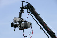 Live recording. Camera on crane in action; blue sky as background Stock Photography