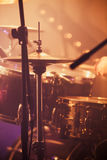 Live rock music background, drummer. Plays with drumsticks on rock drum set. Warm toned closeup vertcial photo, soft selective focus Stock Photography
