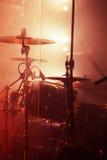 Live rock music background, rock drum set. Warm toned closeup vertical photo, soft selective focus Stock Photos