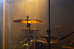 Live rock music photo background, rock drum set. With cymbals in warm stage lights. Close-up photo, soft selective focus stock image
