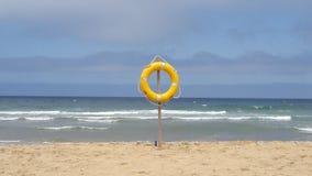 Live saving. Tangier city beach live saving Royalty Free Stock Photography