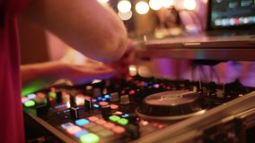 Live show, audio Mixer. Disco and Club DJ hands mixing at night club party. close up, move camera stock video footage