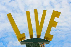 Live Sign with Sky Royalty Free Stock Photos