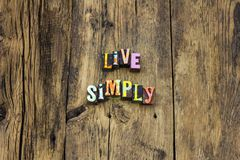 Live simply purity karma believe typography type. Live simply purity karma believe typography letterpress simple life love living modest poor enjoy lifestyle royalty free stock photos