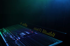 Live Sound. 40ch Live sound board with led meter bridge, and blue/green lights with haze Stock Image