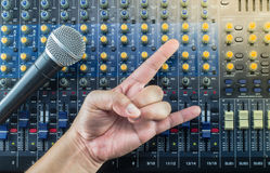 Live Sound Mixers board and music studio Hand symbol Stock Image