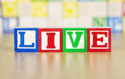 Live Spelled Out in Alphabet Building Blocks Stock Photo