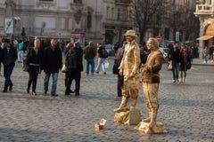 Live statues street artists perform on square. PRAGUE, CZECH REPUBLIC - MARCH 8th, 2014 - Live statues street artists perform on Old Town Square Stock Photo