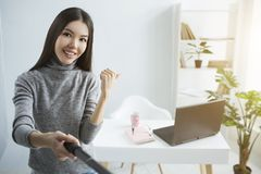 Live stream of girl showing her table in the corner of the room to her followers. Also there are a cup and a notebook royalty free stock image