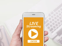 Live Streaming word display on mobile screen hand holding. Royalty Free Stock Photography