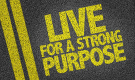 Live For a Strong Purpose written on the road Royalty Free Stock Images