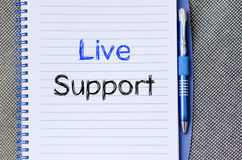 Live support text concept on notebook. Live support text concept write on notebook Royalty Free Stock Image