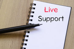 Live support text concept on notebook. Live support text concept write on notebook Royalty Free Stock Photo