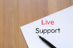 Live support text concept on notebook. Live support text concept write on notebook Stock Images