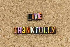 Live thankfully give thanks. Thanksgiving alive thankfully typography letterpress hearts filled with thanks giving charity grateful love living life purity stock photos
