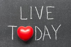 Live today. Phrase handwritten on chalkboard with heart symbol instead of O royalty free stock images
