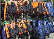 Live Vests. Live vest floaters lined up for use by swimmers Stock Photo