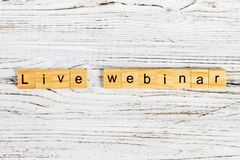Live webinar word made with wooden blocks concept.  Royalty Free Stock Photo