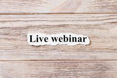 Live webinar of the word on paper. concept. Words of live webinar on a wooden background stock photography