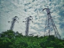 Live Wire Electricity tower Connectivity. A live wire electricity connectivity between two cities or states in India with beautiful sky background royalty free stock photos