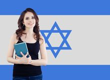 Live, work, education and internship in Israel. Cheerful pretty young woman with Israel flag.  stock image