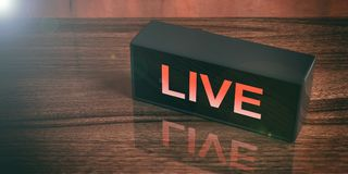 LIVE on a black box isolated on wooden background. 3d illustration. LIVE written on a black box isolated on wooden background. 3d illustration Royalty Free Stock Image