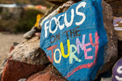 Focus on the journey. On painted rocks stock images