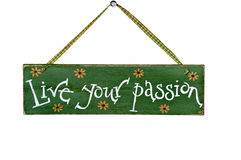 Live Your Passion hand painted on hanging wood sign. Hanging hand-painted wood sign with words Live Your Passion on it royalty free stock photography
