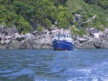 Liveaboard boat on ocean stock photo
