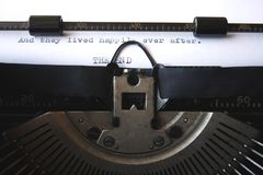 They lived happily ever after. This is typed on an old-fashioned, manual typewriter: And they lived happily ever after. THE END A writer has finished his romance royalty free stock images