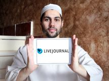 LiveJournal Social networking service logo. Logo of LiveJournal on samsung tablet holded by arab muslim man. LiveJournal is a Russian social networking service royalty free stock image
