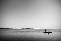 Livelihood. A photo of a husband and wife fishing for a day's meal Royalty Free Stock Photography