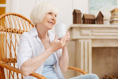 Lively bright lady drinking coffee at home Royalty Free Stock Images