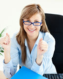 Lively businesswoman smiling with thumbs up Royalty Free Stock Photography