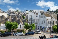 Lively central street in Alberobello, Puglia, Italy. Alberobello, Italy - 11 May, 2014: a view of a beautiful particular extraordinary town in Puglia Royalty Free Stock Image