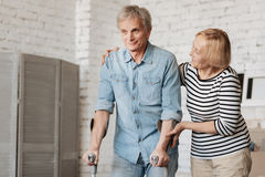 Lively charming senior couple going through recovery together Royalty Free Stock Photography