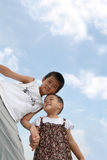 Lively children. Under the blue sky of the two lively children Stock Photo