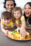 Lively family eating cookies Stock Images