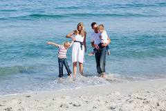 Lively family having fun at the beach Royalty Free Stock Image