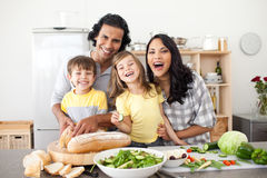 Lively family having fun in the kitchen. Lively family preparing lunch together in the kitchen Royalty Free Stock Photos