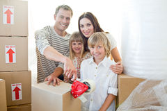 Lively family packing boxes Royalty Free Stock Photo