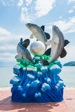 Lively fish and pearl statue on the shore, Thailand. Royalty Free Stock Images