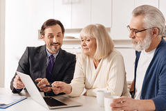 Lively lawyer presenting plan of contract to the clients Royalty Free Stock Images
