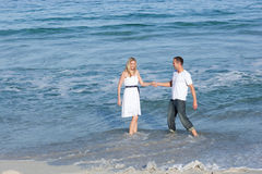 Lively lovers having fun at the seaside Royalty Free Stock Photography