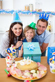 Lively parents celebrating their son's birthday Royalty Free Stock Photography