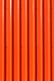Lively red corrugated painted metal wall background. Royalty Free Stock Photography