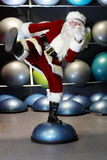 Lively Santa Claus fitness training Stock Photo