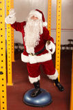 Lively Santa Claus fitness training Stock Photos